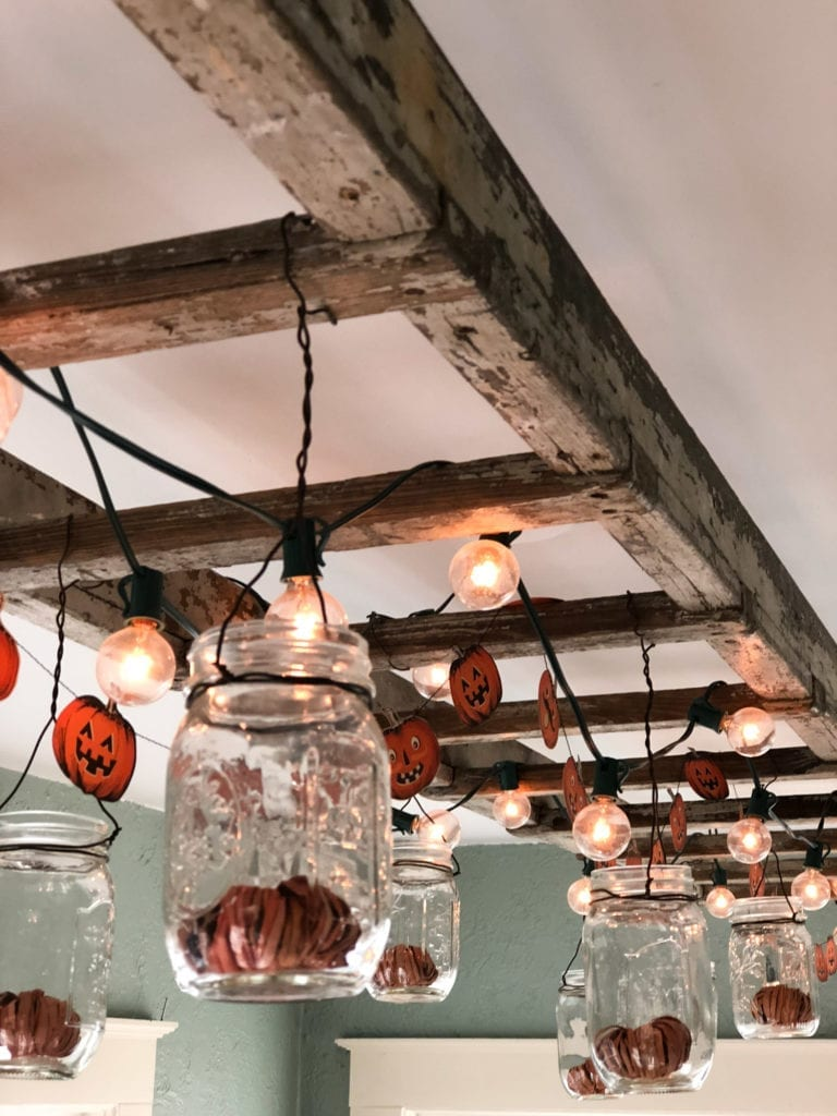 hanging indoor rustic ladder with lights and mason jars